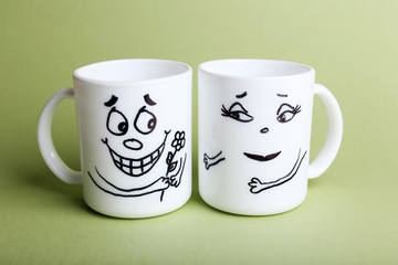 Emotional cups on green background