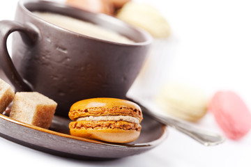Cup of coffee and macaroons on white background, toned