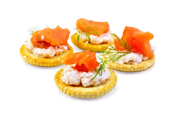 Cracker with cream and salmon