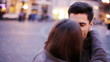 happy couple in love hug and talking in city during evening