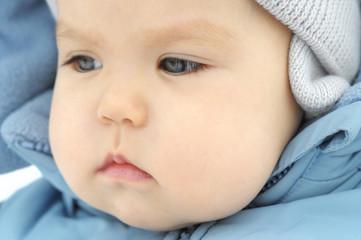 Baby girl in snow suit looking away