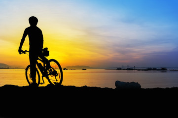 silhouette mountain bike cyclist and great sunrise