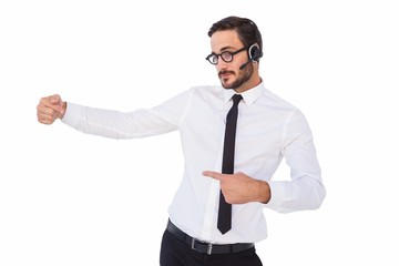 Businessman wearing a headset while showing something