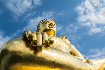 Big golden buddha statue with blue sky at Golden Triangle, Chian