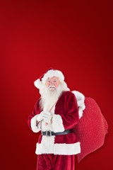 Composite image of santa carries his red bag