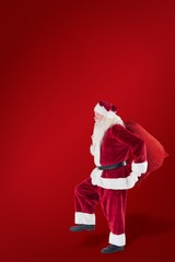 Composite image of santa jumps with his bag