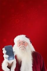 Composite image of santa claus shows a smartphone
