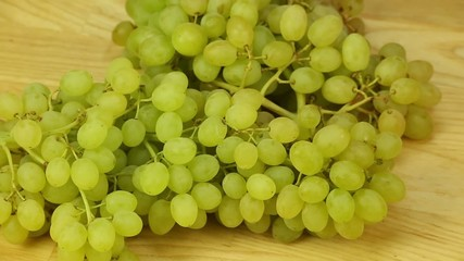 Hron grapes rotates on a wooden boards background