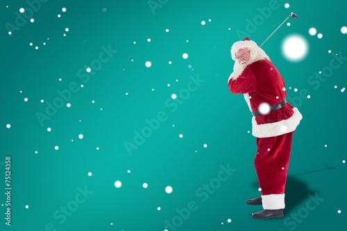 Deurstickers Golf Composite image of santa claus swings his golf club