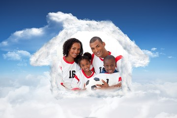 Composite image of smiling family holding a soccer ball