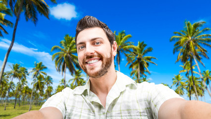 Happy young man taking a selfie photo in the Northeast of Brazil