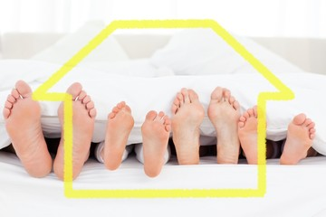 Composite image of feet in bed pointing straight up