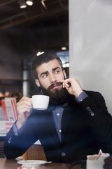 hipster businessman on break for a coffee
