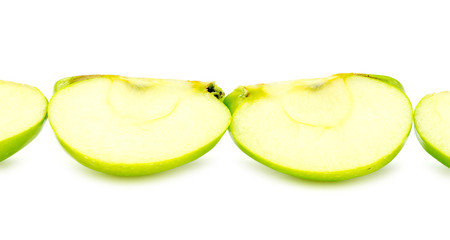 Line of chopped pieces of green apple