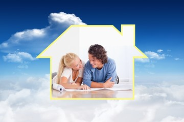 Composite image of smiling couple moving in a new house