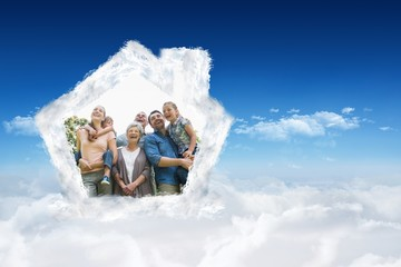Composite image of cheerful extended family at park
