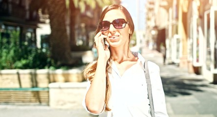 Pretty Young Business Woman Walking Down Street Talking On Phone