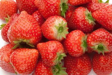 heap of strawberrys on white
