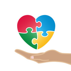 Heart with puzzle on hand.