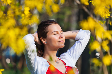 Woman enjoying sunshine in the spring