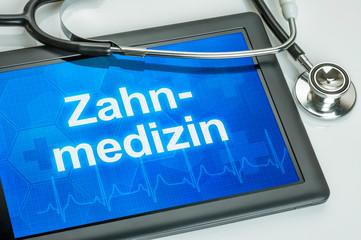 Tablet mit dem Text Zahnmedizin auf dem Display