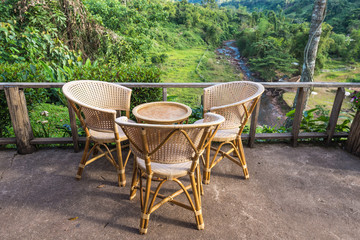 Three chairs with forest view