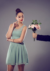 Uninterested female, man giving a bunch of flowers