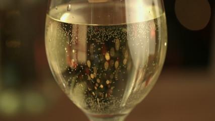 Focus on white wine glass