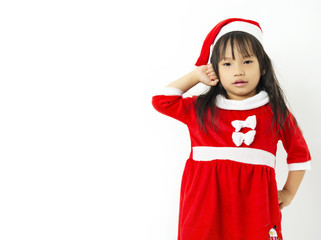 Asian little girl in red santa hat on white background