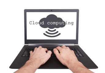 Man working on laptop, cloud computing