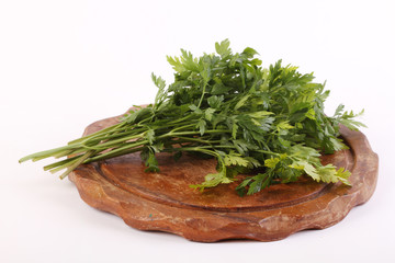 Parsley on a wooden plate