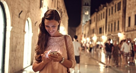 Beautiful Happy Woman Tourist Using Smartphone Tablet Vacation