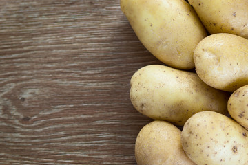 Potatoes on wood background