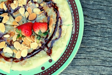 Indian Chapati Breads or roti dough and strawberry fruit.