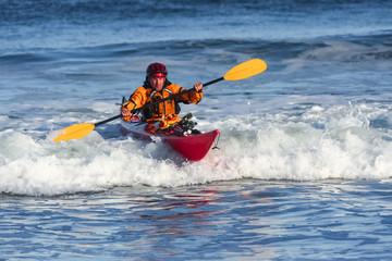 Kayak surfer in action