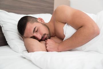 Attractive Man Sleeping In His Bedroom