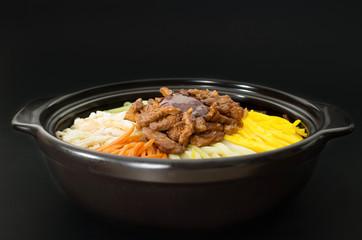 Korean cuisine, beef  Bibimbap in  a clay pot