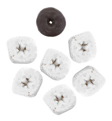 Powdered sugar donuts with one chocolate donut