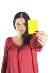 An image of a pretty woman showing yellow card.