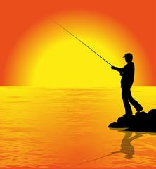 silhouette di pescatore al tramonto