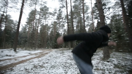 Man running through the woods and doing parkour jump. slo mo