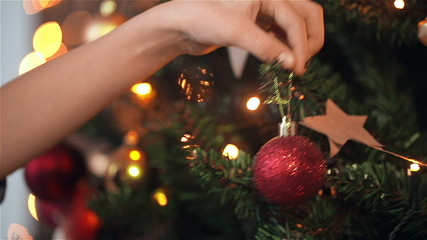 Child girl decorates the Christmas tree. dolly shot