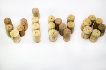 Vino scritto con tappi di bottiglia