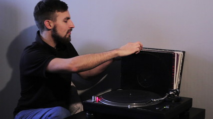 man listening to music and holding a vinyl