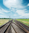 crossing of railroad to horizon under cloudy sky