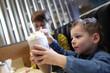 Child eats foam of milkshake