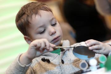Boy making cardboard toy