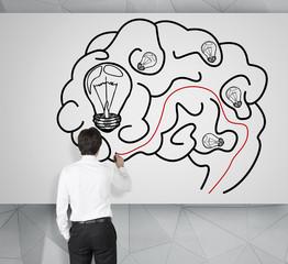 man drawing brain