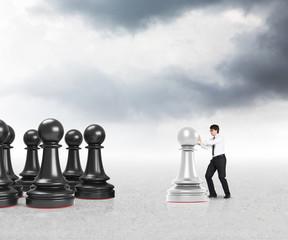 businessman moving white pawns