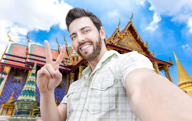 Happy young man taking a selfie photo in Bangkok, Thailand